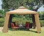 10' x 10' Avalon Gazebo with Netting Outside Setting with patio furniture centered