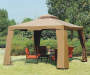 10' x 10' Avalon Gazebo with Netting Outside Setting with patio furniture