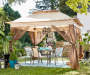 11' x 11' Pop Up Canopy with Netting Open in Environment with patio furniture
