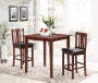 3 Piece Pub Set with Two Chairs and Decorated Table in Room Setting