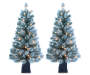 3.5 Foot Dasher Flocked Pre Lit Artificial Christmas Tree in Brown Urn 2 Pack Lights On Silo Image