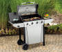 4 Burner 48,000 BTU Stainless Steel Gas Grill on patio