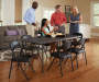 6 Foot Black Center Folding Table with Chairs and Models Lifestyle Image