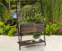 Coral Coast Raised Trellis Planter lifestyle image with props