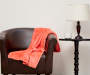 Coral Velvet Plush Throw Posed in Environment Lifestyle Image