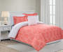 Etty Coral 8 Piece Queen Reversible Comforter Set Coral Side Up Angled View On Left On Bed Lifestyle Image