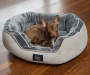 Gray Oval Nester Memory Foam Pet Bed 21 Inches by 25 Inches with Dog Lifestyle Image