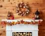 Harvest Red Berry and Burlap Wreath Above Mantel Lifestyle Image