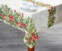Holly and Ribbon Christmas Tablecloth 52 by 70 On Table