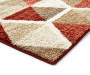 Illusions Red and Brown Accent Rug 2 Feet 6 Inches by 3 Feet 10 Inches Close Up Corner Silo Image