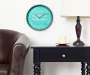 Imagination Aqua and Silver Clock 12 Inches In Room with Pub Chair and Side Table Lifestyle Image