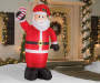 Inflatable Santa with Candy Cane in Front of House Lifestyle Image