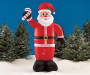 Inflatable Santa with Candy Cane in Snow Outdoor Shot