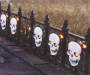 Lighted Skull Fence Angled View Outdoor Shot