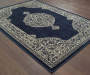 Manor Navy Area Rug 6 Feet 7 Inches by 9 Feet 6 Inches Angled View Lifestyle Image