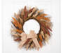 Natural Wreath Hanging From Door Silo Image