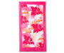 Pink Floral and Flamingo Beach Towel 34 Inches by 64 Inches Overhead View Silo Image
