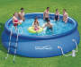 Quick Set Pool 16 Feet by 42 Inches Outdoor Setting with Models Lifestyle Image