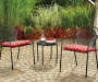 Red Ironwork Outdoor Seat Cushions 2-Pack Lifestyle Image Outdoors on Bistro Set