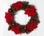 Red Poinsettia Wreath Hanging On Door
