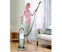 Shark Navigator Deluxe Woman Vacuuming Curtains