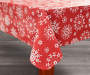 Snowflake Christmas Vinyl Tablecloth 52 Inches by 70 Inches Corner Fold on Table Room View