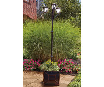 Wilson fisher welcome coco planter with solar light for Walk in greenhouse big lots