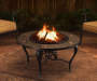 Sunset 35 inch Round Steel Wood Burning Fire Pit Lifestyle Image Lit