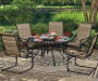 Tahoe Glass Top Patio Table with Lazy Susan and Spring Action Chairs Lifestyle Image