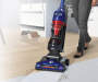 WindTunnel 2 Rewind Pet Vacuum on Carpet by Wood Floor Legs