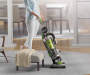 WindTunnel Air Lift Upright Vacuum in Room with Model Lifestyle Image