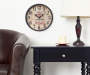 Wine Clock 12 Inches in Room Setting with Pub Chair and Side Table Lifestyle Image