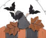 Wooden Happy Halloween Pumpkin Wall Decor with Black and Orange Stripes and Bat Ornaments Close Up Detail Silo Image