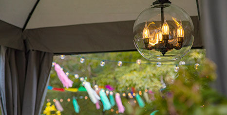 Pair a chandelier with your new gazebo for cozy lighting