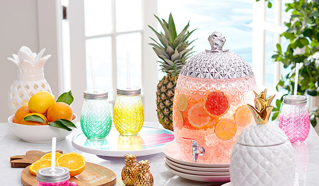 Create a tropical tablesetting with pineapple themed serveware from Big Lots