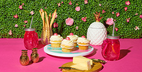 Cupcakes are the perfect playful snack to serve with this bright tropical party decor