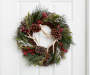 22 Inch Circle Wreath with Green Pine Needles, Pinecones, Red Berries, Frosted Like Branch Accents and Faux Deer Antler Ornaments on Twig Background On a White Door Front View Environment Image