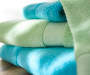 Aqua Bath and Cameo Green Towel Lifestyle Folded and Stacked
