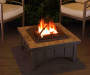 Avondale 34 inch Slate Top Wood Burning Fire Pit Lifestyle Image with FIre Lit
