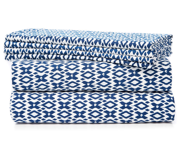 Blue and White Ikat Diamond 6 Piece Queen Sheet Set Stacked and Folded Silo Image