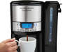 BrewStation Summit 12 Cup Dispensing Coffee Maker silo front with coffee cup prop