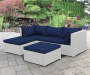 Brook White All Weather Wicker Sectional and Ottoman with Blue Cushions Lifestyle Patio