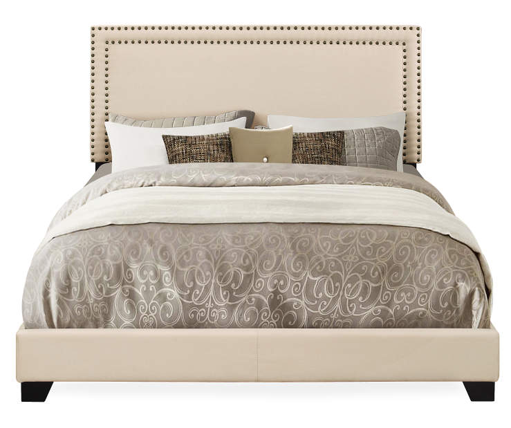 Cream Upholstered Queen Bed with Nailhead Trim silo front with linen prop