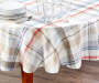 Farmhouse Red and Blue Plaid Fabric Tablecloth 70 inches On table with glassware