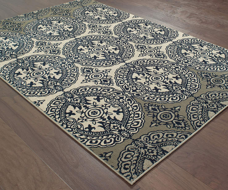 Florence Navy Area Rug 5FT3IN x 7FT6IN  On Wood Floor