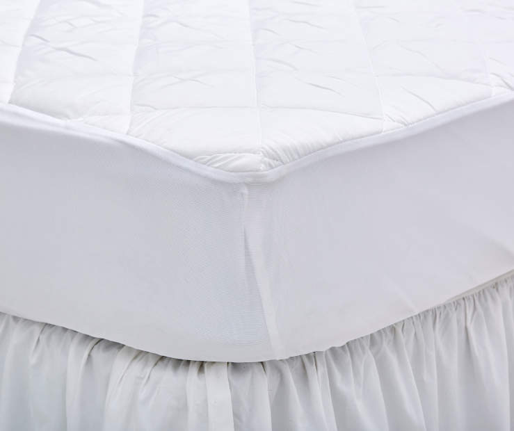 Full Waterproof Mattress Pad on Corner Bed Lifestyle Image