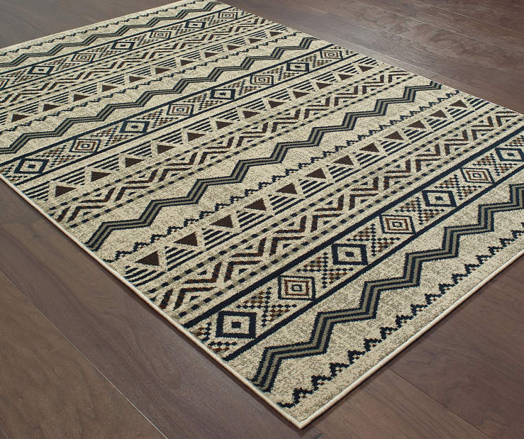 Griggs Gray Area Rug 6FT7IN x 9FT6IN On Wood Floor
