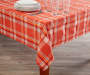 Harvest Orange Plaid Tablecloth 60 inch x 84 inch lifestyle on table