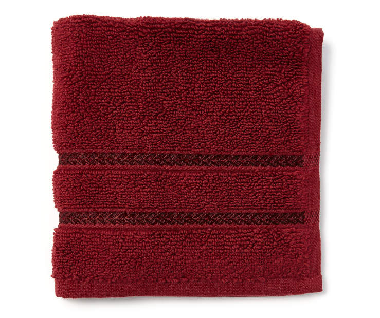 Hotel Cabernet Red Wash Cloth Folded Overhead View Silo Image
