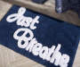 Just Breathe Navy Blue and White Cotton Bath Rug Lifestyle Image Bathroom
